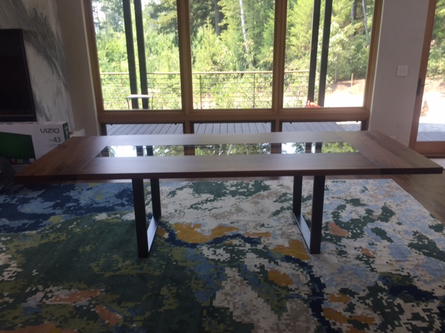 Glass, walnut and steel dining table in Teton Village, WY residence